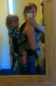 The Ergo Baby carrier - you can see in the picture that it's quite low down on her back